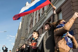 Activists demand Putin's resignation in massive rally