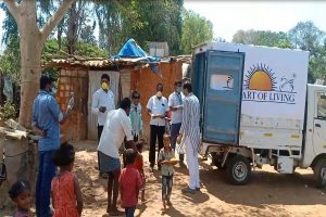 Art of Living with IAHV provide relief materials to migrant workers