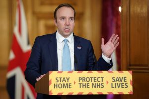 UK health minister back at work after COVID-19 recovery, pledges more tests