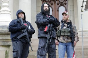 Protesters carrying guns storm Michigan capitol building seeking lockdown end