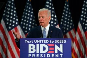 US Democratic presidential candidate Joe Biden accuses Donald Trump of 'surrendering' to Coronavirus