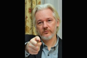 WikiLeaks founder Julian Assange accused of conspiring with 'anonymous' hackers