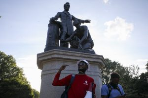Thousands of protesters raise demand to remove statues of slave kneeling before Lincoln
