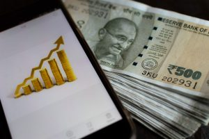 Rupee settles 8 paise higher at 75.54 against US dollar