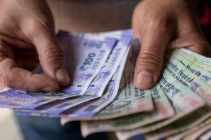 Rupee slumps against US dollar, settles at 76.03 per USD