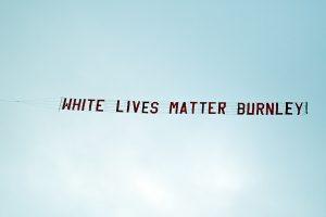 'White Lives Matter' banner flies over stadium during Manchester City-Burnley Premier League match