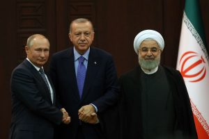 Iran, Russia, Turkey urge political solution to Syrian crisis