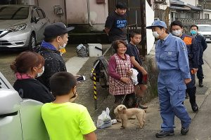 Japan PM Shinzo Abe visits flood-hit region, pledges financial support