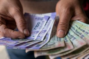 Rupee slides 9 paise lower settles at 75.02 per USD