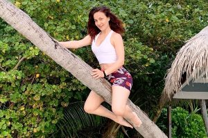 Elli AvrRam turns a flying witch riding the stick on Halloween