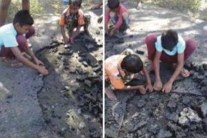 Kids scrape bitumen off after road-laying work