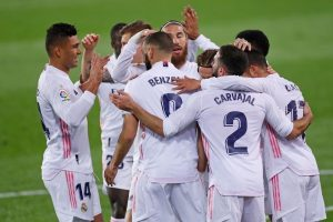 Real Madrid beat Granada 2-0 to join table topper Atletico Madrid in terms of points