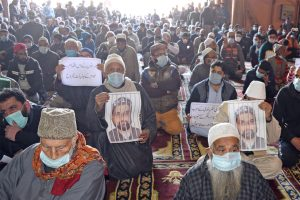 People offer Friday prayers in Srinagar mosque carrying photos of detained Mirwaiz, demand his release