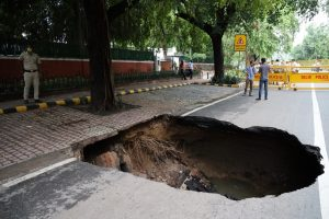 Road caves in, house collapses due to rain in Delhi