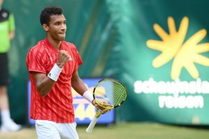 Auger-Aliassime rallies to beat childhood idol Federer