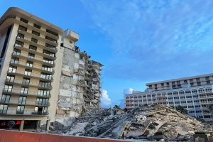 Demolition expedites search at condo site as storms threaten
