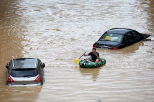Thousands evacuated as floods hit China