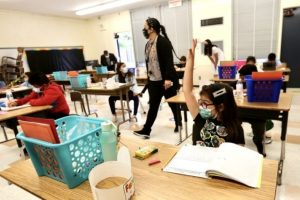 US CDC issues new school guidance, urges full reopening