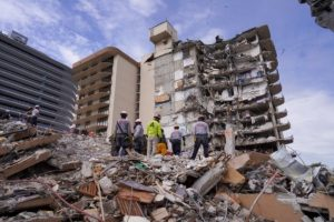 Rescuers unrelenting as toll rises to 64 in condo collapse