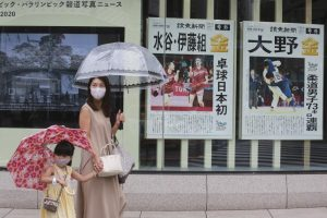 Tokyo logs record virus cases days after Olympics begin