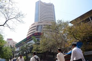 Equity indices flat amid weak global cues, banking stocks fall