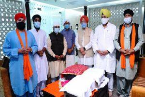 Hardeep Puri receives Sri Guru Granth Sahib brought from Kabul