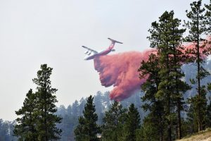 Wildfire bears down on Montana towns as West burns
