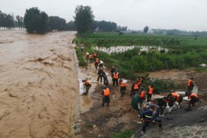 Death toll from floods in China's Henan reach 302