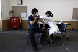 Japan medical workers likely to get 3rd shot