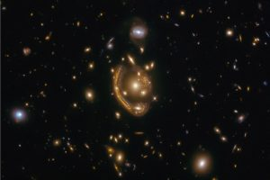 Hubble's new 'molten Einstein ring' image prompts new research