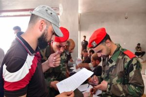 Armed rebels surrender in Syria's Daraa amid new deal