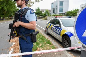 Man who assaulted six shot dead by NZ police, PM says 'terrorist attack'