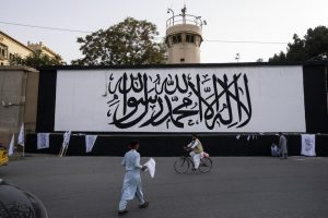 Taliban flag rises over seat of power on fateful anniversary